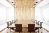 Modern conference interior with blank wooden wall, equipment and city view. Mock up, 3D Rendering