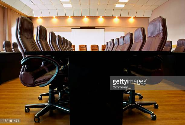Conference room with several chairs and long desk