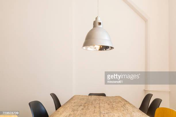 Conference table and ceiling light in a loft