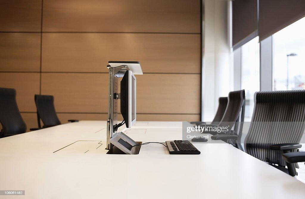 Conference table and hi-tech computer on it : Stock Photo