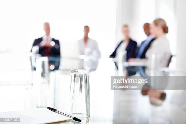 Conference Table With Business People Sitting in the Background