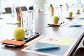 Closeup of conference table with water and stationery sets