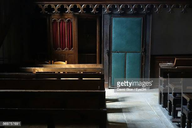Confession Booth By Pews In Church