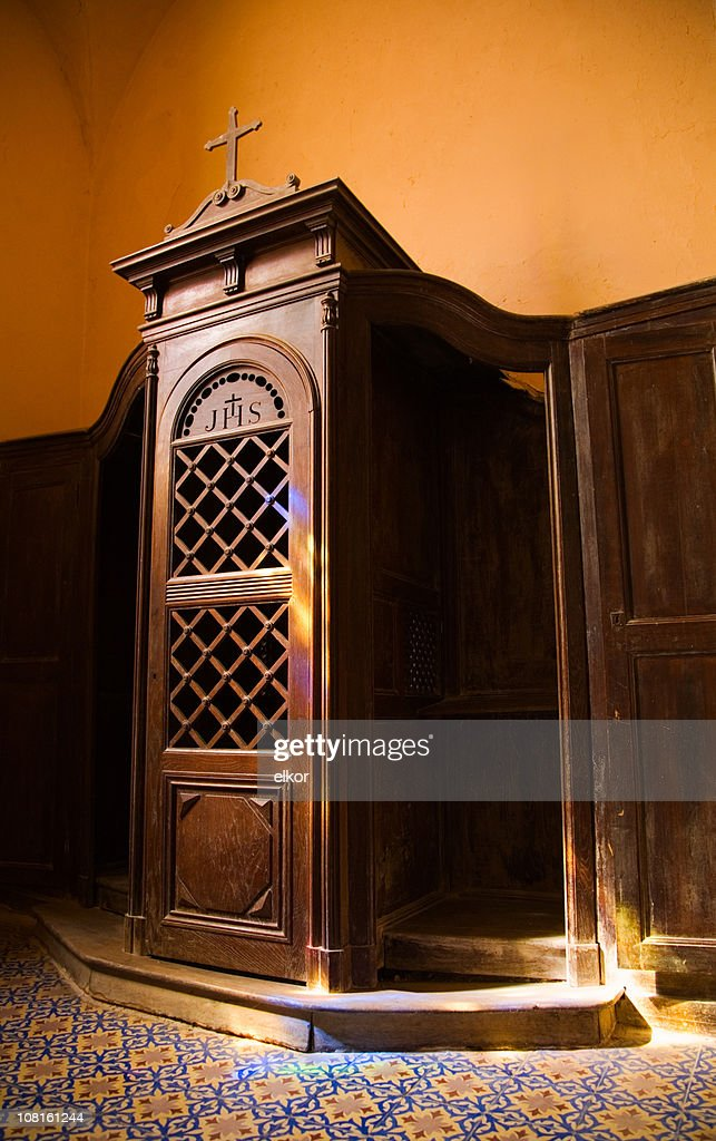 Confession Booth with Stained Glass Window Reflection : Stock Photo
