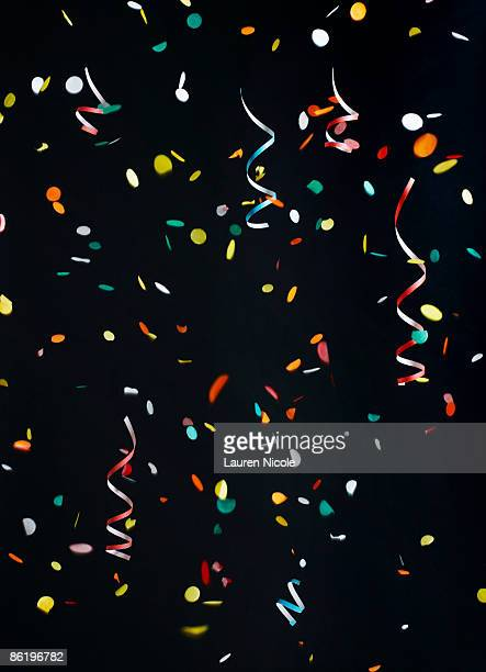 Confetti and Streamers on Black Background