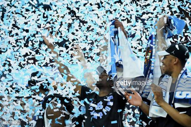 Confetti drops on Theo Pinson of the North Carolina Tar Heels and teammates after winning during the 2017 NCAA Men's Final Four National Championship...