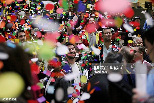 Confetti drops on traders and clerks as they work on the financial floor at the CME Group Inc's Chicago Board of Trade in Chicago Illinois US on...