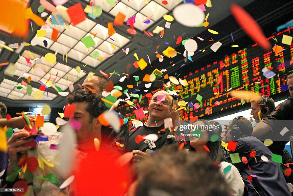 Confetti drops on traders and clerks in the Eurodollar options pit at the CME Group's Chicago Board of Trade in Chicago, Illinois, U.S., on Friday, Dec. 31, 2010. The dollar weakened for a third day against the euro, while stocks and currencies in emerging markets climbed as confidence in the economic recovery prompted investors to purchase riskier assets. Photographer: Tim Boyle/Bloomberg via Getty Images