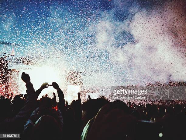 Confetti falling on crowd at concert