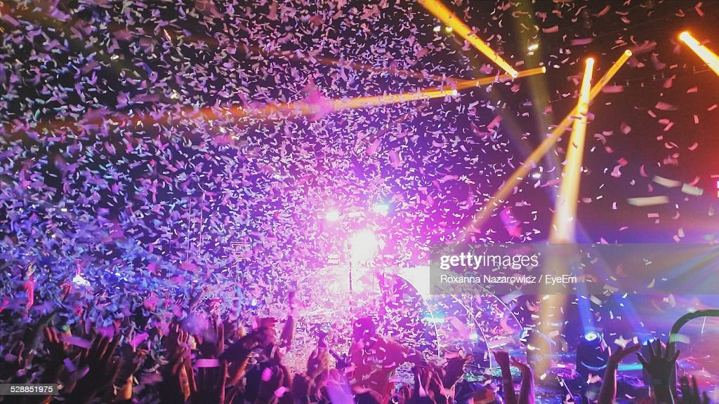 Confetti Falling On Crowd At Concert : Stock Photo