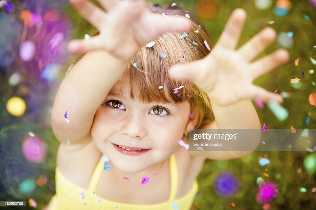 Confetti Falling On Little Girl : Stock Photo