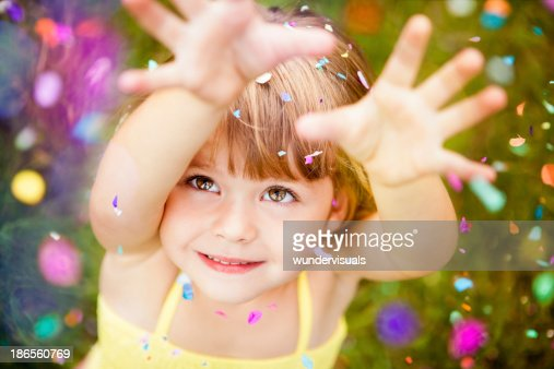 Confetti Falling On Little Girl