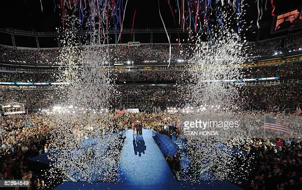 Confetti falls as Democratic Presidential Illinois Senator Barack Obama his wife Michelle VicePresidential candidate Delaware Senator Joe Biden and...