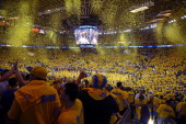 Confetti falls as fans celebrate the Golden State Warriors victory against the Los Angeles Clippers in Game Six of the Western Conference...