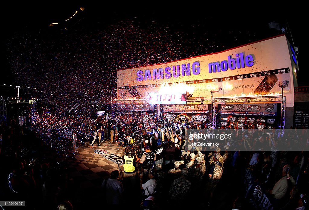 Confetti falls as <a gi-track='captionPersonalityLinkClicked' href=/galleries/search?phrase=Greg+Biffle&family=editorial&specificpeople=209093 ng-click='$event.stopPropagation()'>Greg Biffle</a>, driver of the #16 Filtrete Ford, celebrates in victory lane after winning the NASCAR Sprint Cup Series Samsung Mobile 500 at Texas Motor Speedway on April 14, 2012 in Fort Worth, Texas.