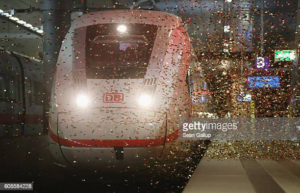 Confetti falls as the new Deutsche Bahn ICE 4 highspeed train arrives for its official presentation at Berlin's Hauptbahnhof main railway station on...