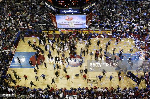 Confetti falls from the rafters after as the Detroit Pistons celebrate defeating the Los Angeles Lakers 10087 in game five of the 2004 NBA Finals on...