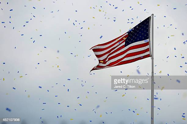 Confetti falls in Victory Lane following the NASCAR Sprint Cup Series Camping World RV Sales 301 at New Hampshire Motor Speedway on July 13 2014 in...