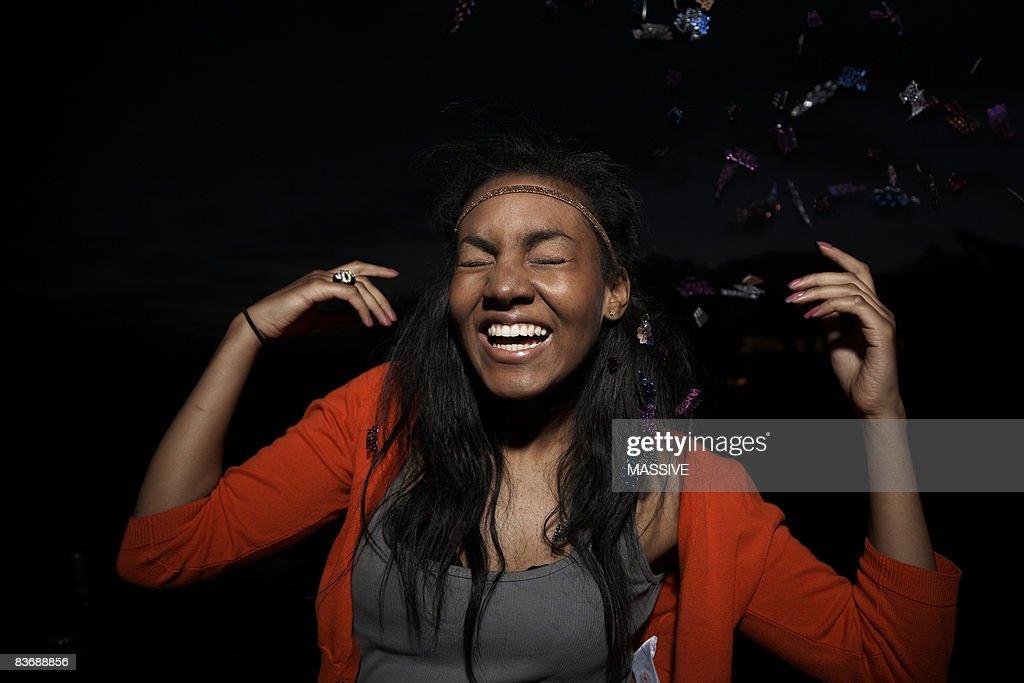Confetti falls on girl : Stock Photo