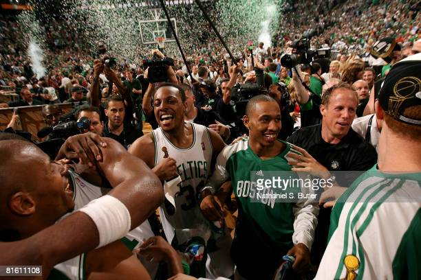 Confetti falls over the arena as Ray Allen Paul Pierce and Gabe Pruitt of the Boston Celtics celebrate amid fans after defeating the Los Angeles...