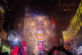 Confetti falls throughout Times Square during the New Years Eve celebration on January 1 2013 in New York City An estimated one million revelers from...