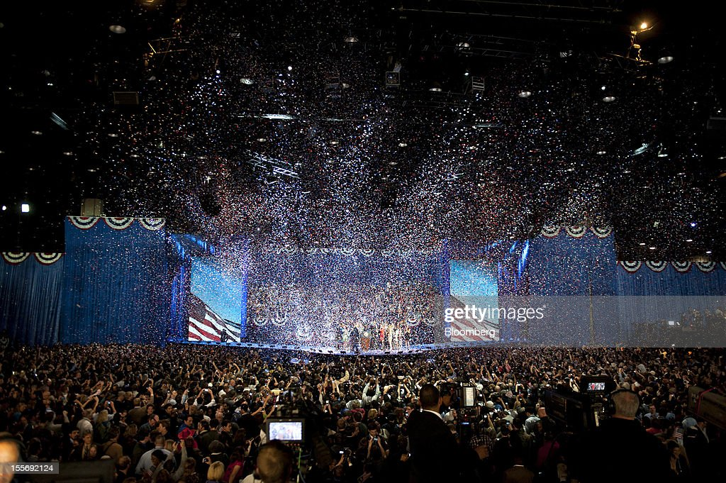 Confetti fills the air during an election night rally in Chicago, Illinois, U.S., in the early morning on Wednesday, Nov. 7, 2012. President Barack Obama, the post-partisan candidate of hope who became the first black U.S. president, won re-election today by overcoming four years of economic discontent with a mix of political populism and electoral math. Photographer: Daniel Acker/Bloomberg via Getty Images