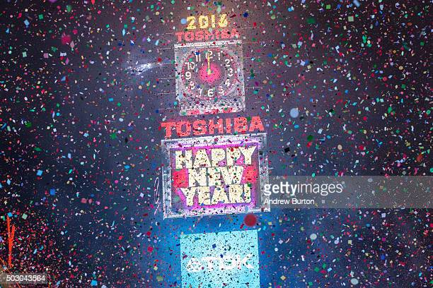 Confetti floats through the air as the new year is rung in in Times Square on January 1 2016 in New York City The New York City Police Department...