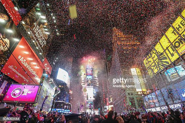 Confetti fly over the Time Square after the clock strikes midnight during the new year celebrations on January 1 2016 in New York City