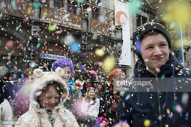 Confetti in the Town Hall Square Music dance party and costumes in Binche Carnival Ancient and representative cultural event of Wallonia Belgium The...