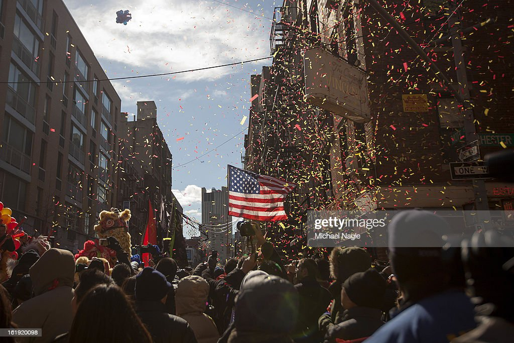 Confetti is blown into the air at the start of the 14th Annual Chinatown Lunar New Year Parade on February 17, 2013 in New York City. This year celebrates the Year of the Snake.