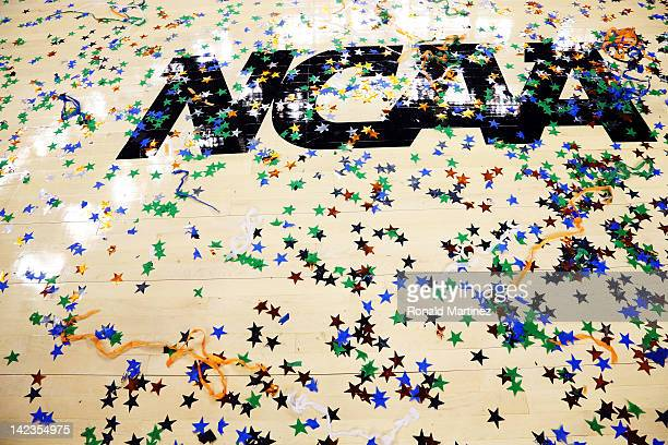 Confetti is seen on the NCAA logo after the Kentucky Wildcats defeat the Kansas Jayhawks 6759 in the National Championship Game of the 2012 NCAA...