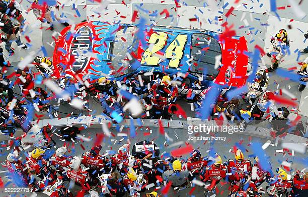 Confetti rains down on Jeff Gordon and the Dupont Hendrick Motorsports Chevrolet team after victory during the NASCAR Nextel Cup Daytona 500 on...