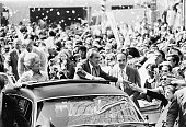 Confetti rains down on Peachtree Street as President Richard Nixon and First Lady Pat Nixon greet the crowds from their motorcade in Atlanta