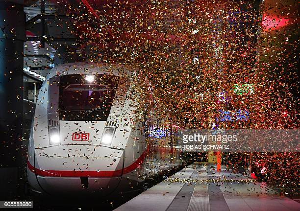 Confettis are sprayed over the new ICE 4 high speed train of German railway operator Deutsche Bahn as it arrives at Berlin's main railway station...