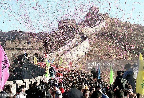 Confettis rain down on nearly five hundred newlywed couples celebrating their wedding day on the Great Wall of China at Badaling north of Beijing 31...