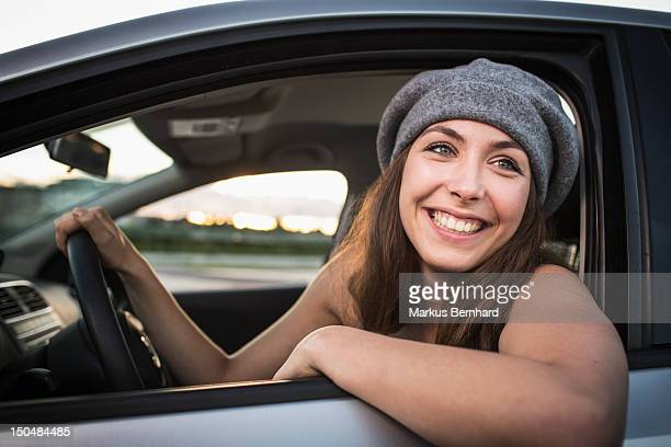 Confidence Woman sitting in car.