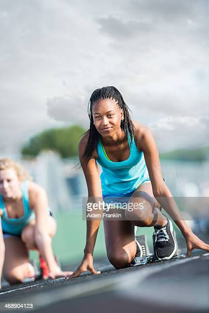 Confident African American Athletic Student at Starting Line of Race
