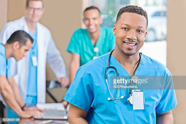 Confident African American male nurse at staff meeting