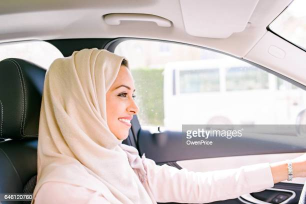 Confident Arabic woman driving
