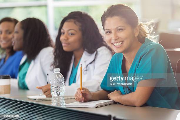 Confident Asian med student in class