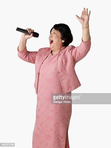 Confident Asian woman singing