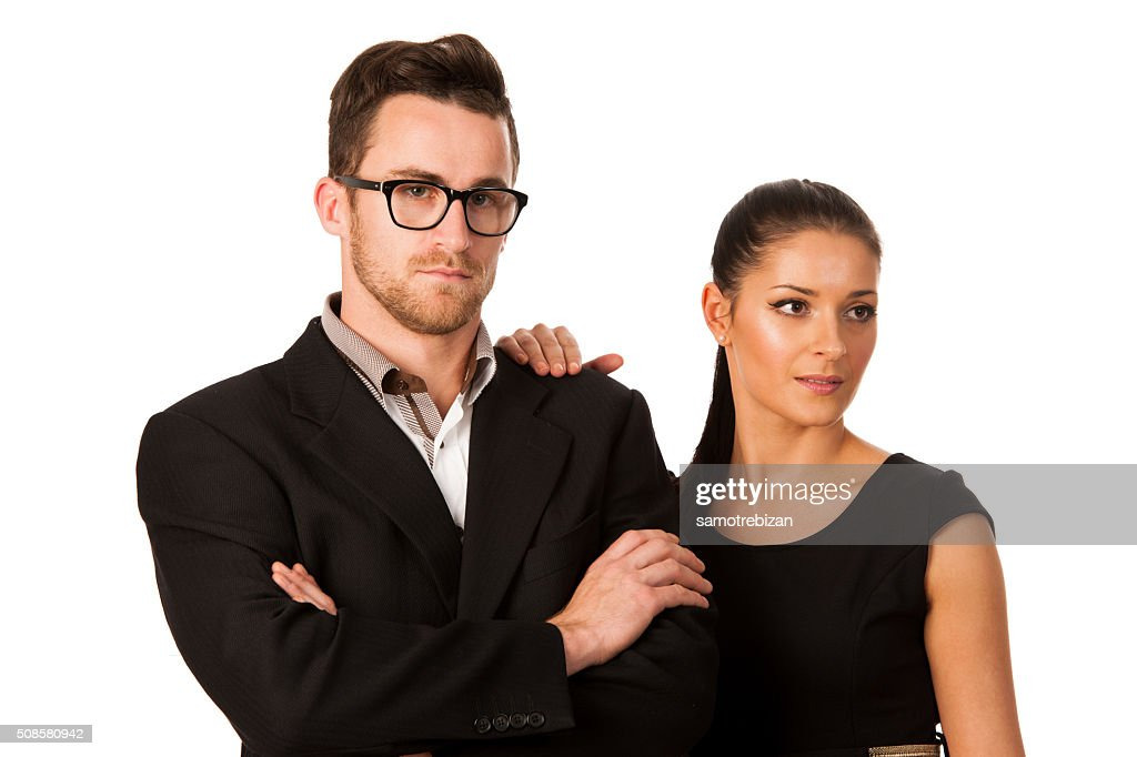 Confident business couple standing next to each other. : Stockfoto