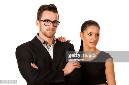 Confident business couple standing next to each other. : Stock Photo