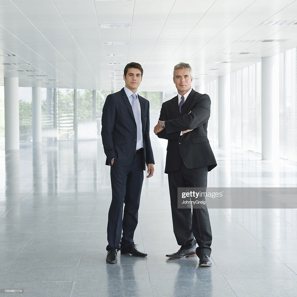 Confident Business Executives In Office Lobby
