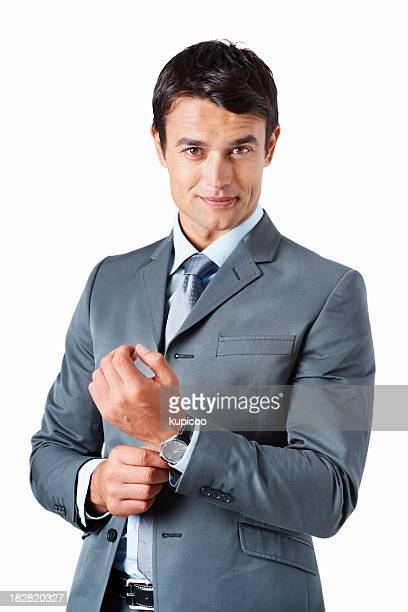 Confident business man adjusting his watch