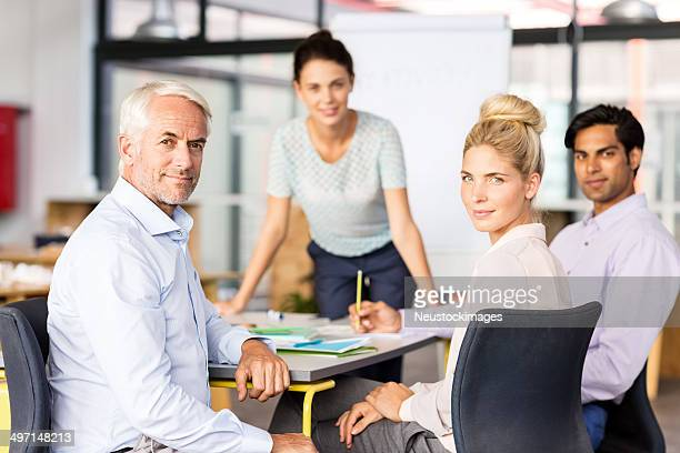 Confident Business People In Board Room
