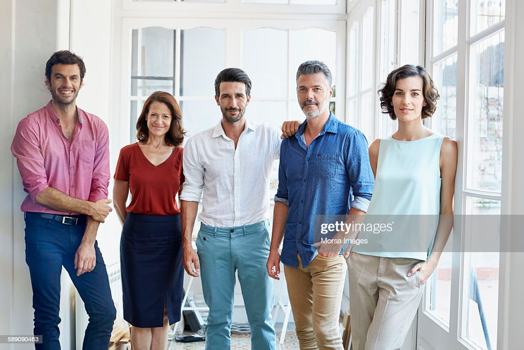 Confident business people standing in office : Stock Photo