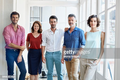 Confident business people standing in office