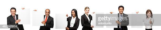 Confident business people with blank signs