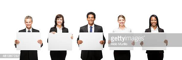 Confident business people with commercial signs